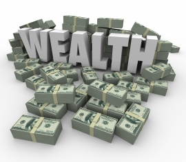 wealth word & piles of money wealth accumulation stock photo